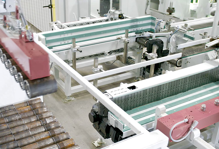 Transfer of the pipe couplings from the container using a flexible magnetic gripper and placement in rows on the loading portal